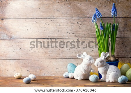 art Happy Easter Day; family Easter bunny and Easter eggs - stock photo