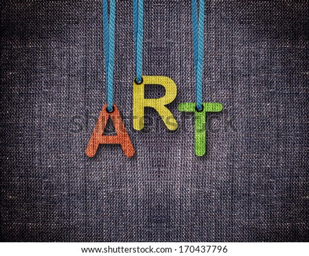 Art letters hanging strings with blue sackcloth background. - stock photo