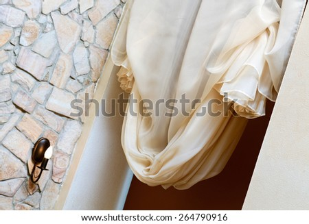 Art nouveau style curtain in window frame, interior detail - stock photo