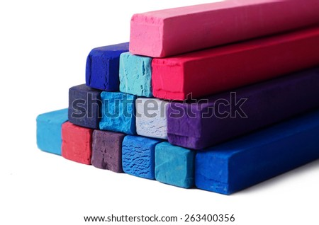 Art objects background - red,blue,violet and purple pastel colorful crayons on white background - stock photo
