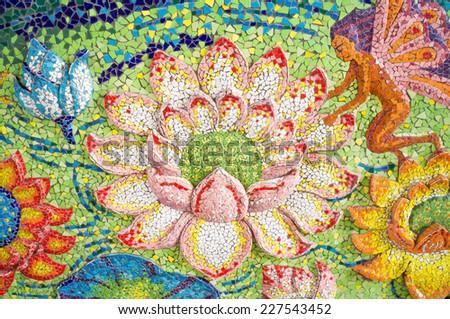 Art of glazed tile lotus and fairy on sanctuary' wall in Ban Rai temple, Korat, Thailand - stock photo