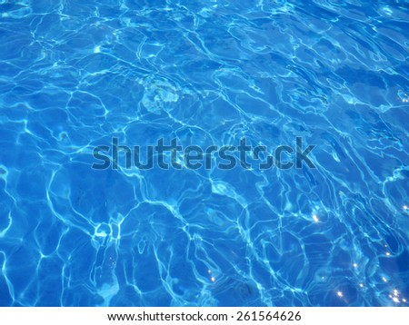 Art of water in the swimming pool with a wave