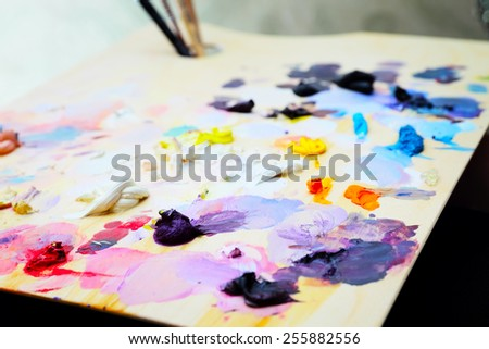 art paint palette with brushes and colorful paints - stock photo
