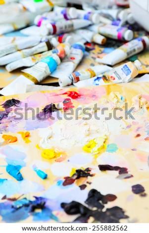 art paint palette with colorful paints, close up - stock photo