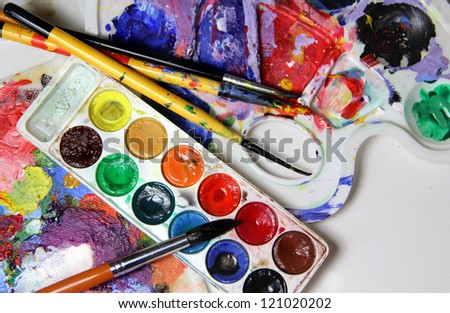 Art palette, watercolors, brushes and water - stock photo