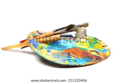 Art palette with paint and a brush on white background  - stock photo