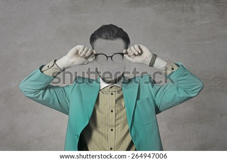 Art Photo of a young man without a face. Green suit and glasses. Hipster. - stock photo