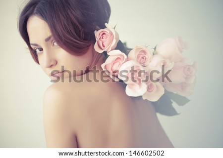 Art photo of charming young lady with roses - stock photo
