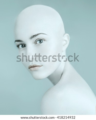 Art portrait of a beautiful sexy girl with no hair