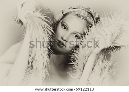 Art portrait of a snow female model in fur.  Fashion, beauty.