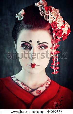 Art portrait of a stylized Japanese geisha. Body painting project. - stock photo