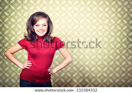 art portrait of young smiling ecstatic woman in room with vintage wallpaper, retro stylization 60-70s, toned - stock photo