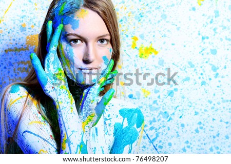 Art project: beautiful woman painted with many vivid colors. - stock photo