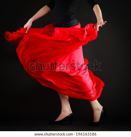 Art. Red skirt of spanish girl woman perfomer dancer dancing flamenco traditional dance. - stock photo