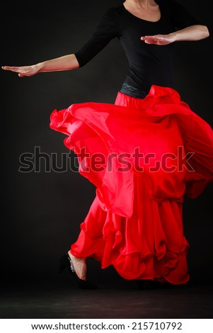Art. Red skirt of spanish girl woman performer dancer dancing flamenco traditional dance. - stock photo