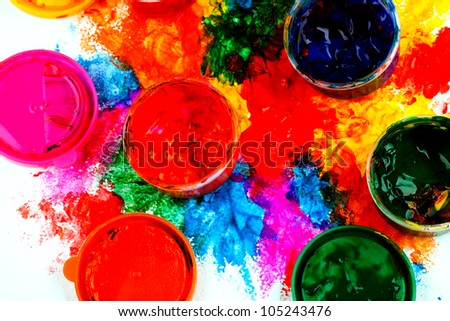 art studio paints on the white with paintings.close up - stock photo
