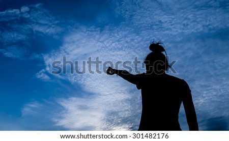 Art tone of woman silhouette with beautiful sunset sky background - stock photo