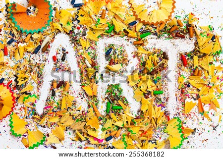 ART word on the background from colored pencil shavings - stock photo