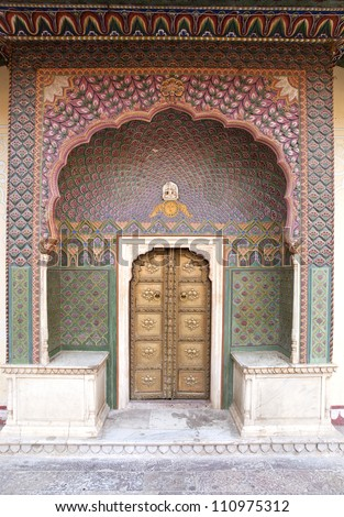 Art work on the small gate to the inner courtyard of the City Palace of Jaipur, Rajasthan, India. - stock photo