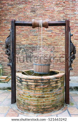Artesian wells made of brick and wood