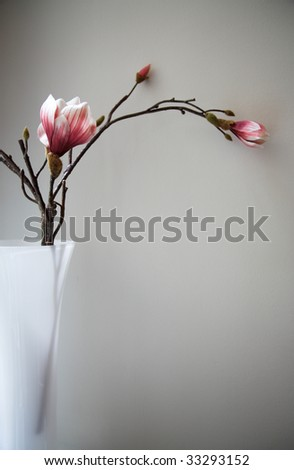 Artfifcial textile flower in vase - stock photo