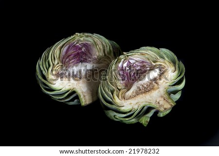 Artichoke Cut in Two Isolated on Black - stock photo
