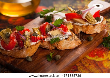 Artichoke toasts with grilled red pepper - stock photo