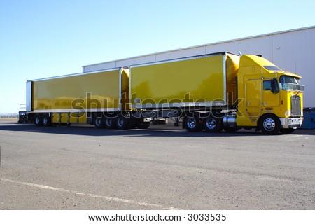 Articulated semi truck twin trailer - stock photo