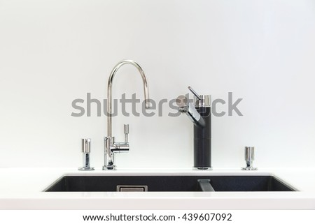 Artifical stone sink and two faucets - stock photo