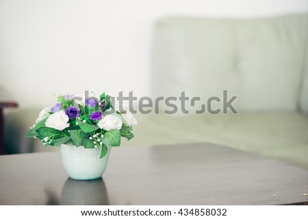 Artificial Beautiful vintage bouquet in white vase on the wooden table.Selective focus. - stock photo