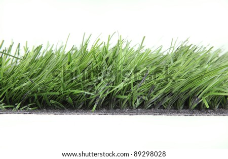 Artificial, fake Grass used on sports fields for soccer, baseball, golf and football - stock photo