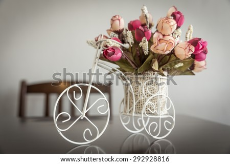 Artificial flowers and antique tricycle for decoration , Vintage style, Artificial flowers of modern - stock photo