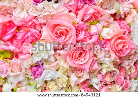 Artificial flowers background - stock photo