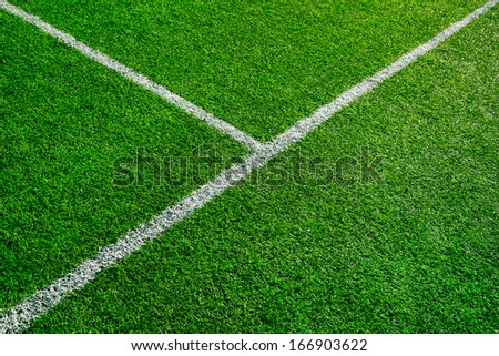 Artificial football field detail with white lines. - stock photo