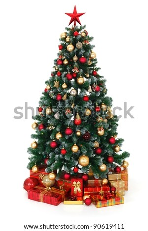 Artificial green Christmas tree, decorated with electric lights, red and golden ornaments, lots of presents under the tree