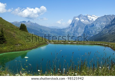 artificial lake in the Swiss Alps - stock photo