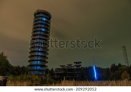 Artificial lightning and discharge in Pulse Voltage Generator (9 MV) tower of Testing Stand in High-Voltage Research Centre.   - stock photo