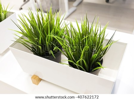 Artificial Plants or Artificial Grass in A Wooden Container for Home and Office Decoration without The Care. - stock photo