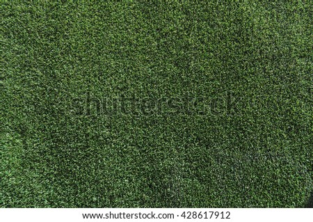 Artificial synthetic grass meadow useful as a background