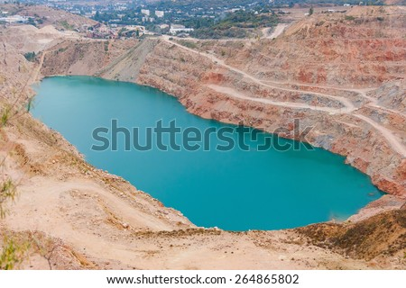 Artificial the quarry with blue water near Balaklava. Sevastopol. Ukraine. Russia - stock photo