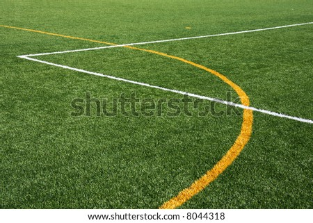 Artificial turf field, showing yellow and white lines - stock photo