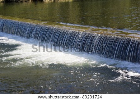 artificial water degree on river in mountain - stock photo