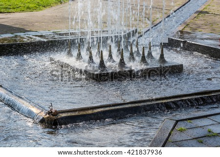 Artificially designed waterfall, fountain - Fountain in a park.