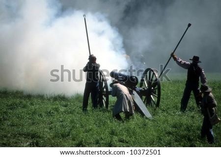 Artillery firing, duringCivil War battle reenactment - stock photo