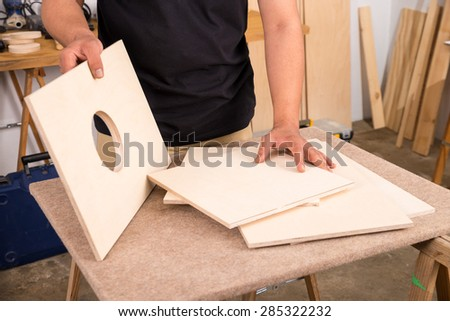 Artisan in his workshop assembling a traditional Spanish cajon, a flamenco percussion instrument - stock photo