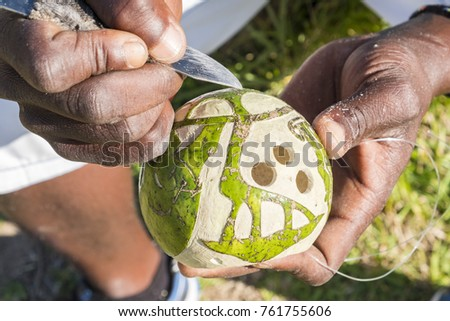 Artisan is carving on a monkey orange bowl at Isimangaliso wetland park South Africa