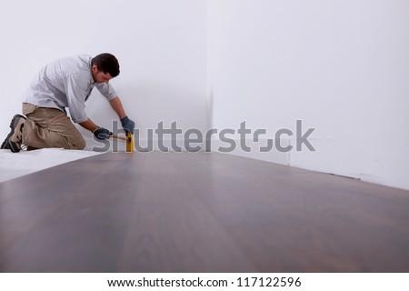Artisan laying parquet - stock photo