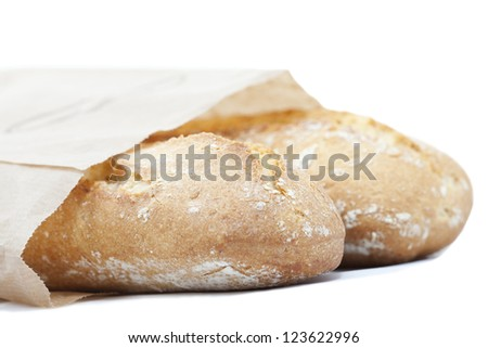 Artisan loaves wrapped in a paper bag - stock photo