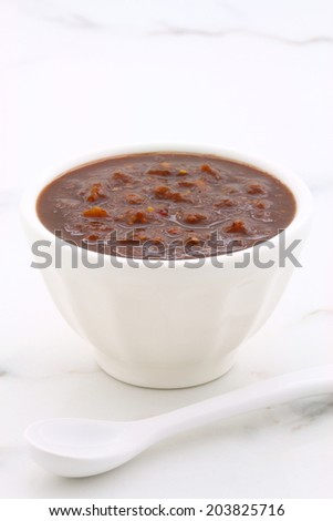 Artisan mexican chipotle sauce on vintage carrara marble table, with a delicious smoky flavor perfect for all your Mexican, tex-mex recipes and sides. - stock photo