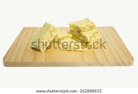 Artisanal white chocolate with lemon chunks isolated on white background - stock photo